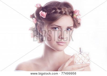Young Beautiful Model Showing A Fragrance Bottle
