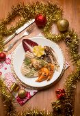 picture of chicory  - mixed grilled fish with red chicory over christmas table - JPG