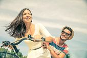 picture of lovers  - Happy couple riding bikes in the city  - JPG