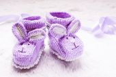 picture of booty  - Knitted purple baby booties with rabbit muzzle over fur - JPG