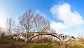 stock photo of arch foot  - Long concrete arch bridge over Parseta river Poland - JPG
