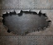 stock photo of alloy  - damaged metal armor with torn hole steam punk background - JPG