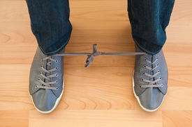 foto of fool  - April fools with shoelaces of trainers at home - JPG