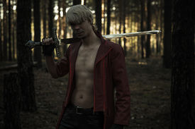 picture of sword  - fantasy hero with a sword in the forest - JPG