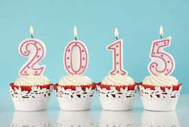 picture of red velvet cake  - Happy New Year for 2015 red velvet cupcakes in red and white theme with lit candles and pale blue and white background - JPG