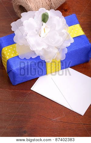 blue gift box on wooden plate, holiday concept