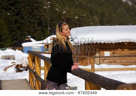 A Beautiful Young Blonde Lady, In A Snowy Winter Landscape