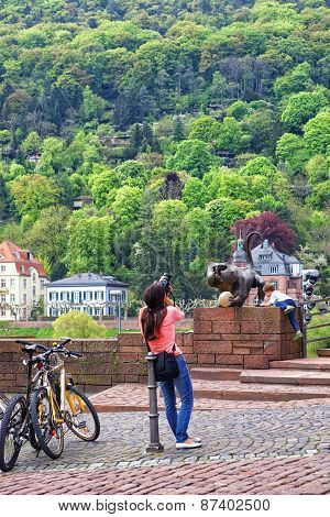 Boy Playing Near Monkey Statue On The Bridge In Summer Heidelberg