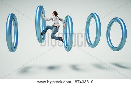 caucasian man jump inside of 3d ring