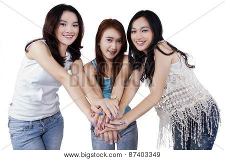 Beautiful Girls Gathering Hands In Studio