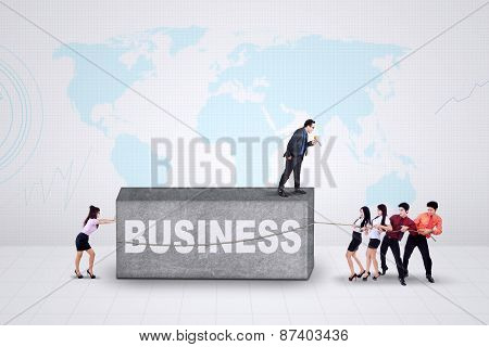 Businesspeople And Hurdle Stone
