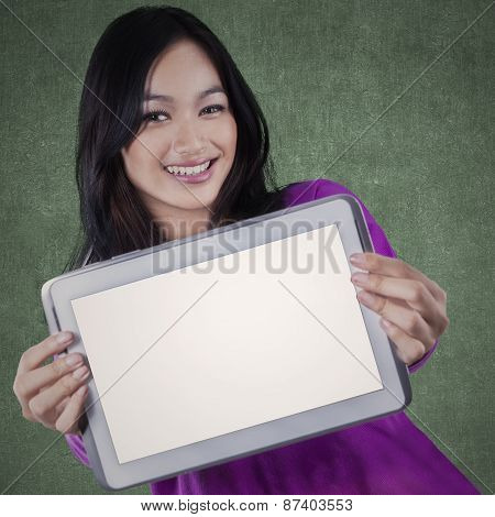 Casual Schoolgirl With Empty Tablet Screen