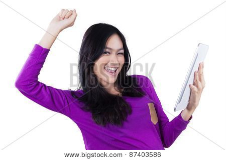 Cheerful Girl With Tablet Celebrate Her Success