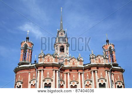 MOZHAISK, RUSSIA - JUN 08, 2014: The building Nicholas Cathedral in the pseudo-Gothic style red-brick against the sky