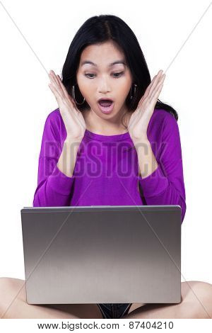 Girl With Laptop Looks Shocked