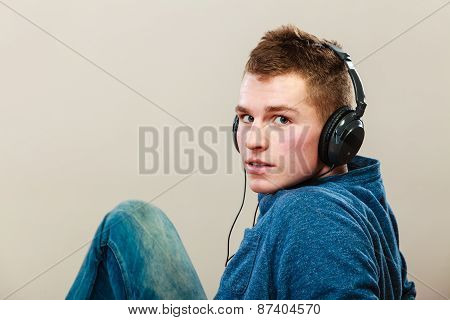 Young Man With Headphones Listening Music