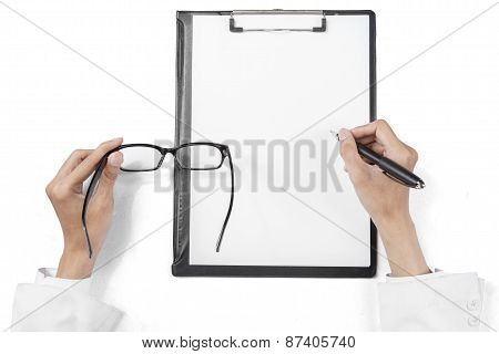 Physician Hands With Glasses Writing On Clipboard