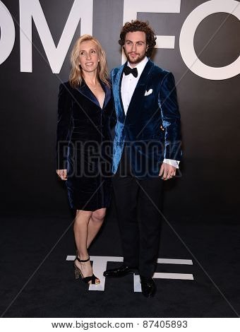LOS ANGELES - FEB 20:  Aaron Taylor-Johnson & Sam Taylor-Johnson arrives to the Tom Ford Autumn/Winter 2015 Womenswear Collection Presentation  on February 20, 2015 in Hollywood, CA