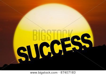 Success Text On The Hill At Sunset