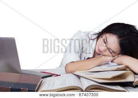 Teenage Female Student Sleeping Above Book