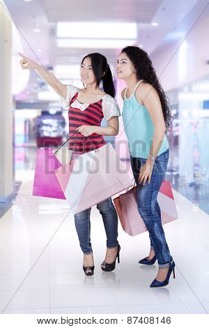 Two Attractive Girl In Shopping Center