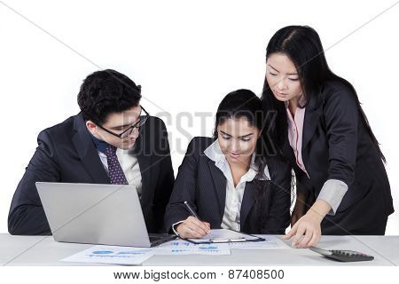Two Managers Looking Their Partner Signing Document