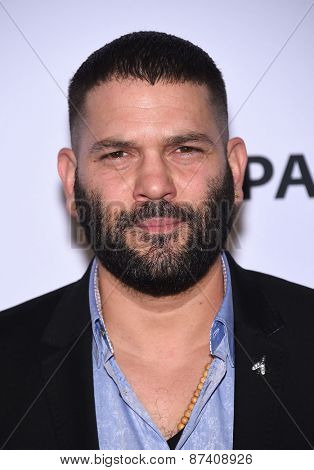 LOS ANGELES - MAR 08:  Guillermo Diaz arrives to the Paleyfest 2015
