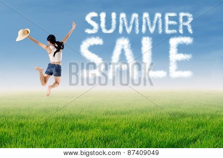 Woman Jumps With Summer Sale Cloud