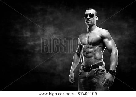 Guy On The Dark Background With Sunglasses