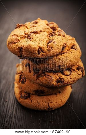 Pile of chocolate cookies on wooden table