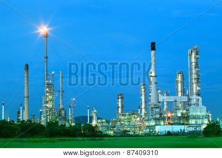 Beautiful Lighting Of Oil Refinery Industry Estate Plant With Fresh And Green Environment Foreground
