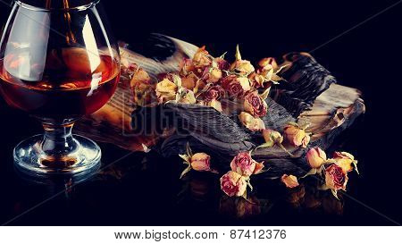 Rose Petals On Books And glass of wine.