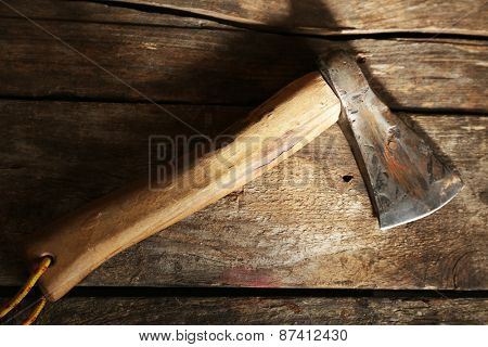 Sharp axe on wooden background