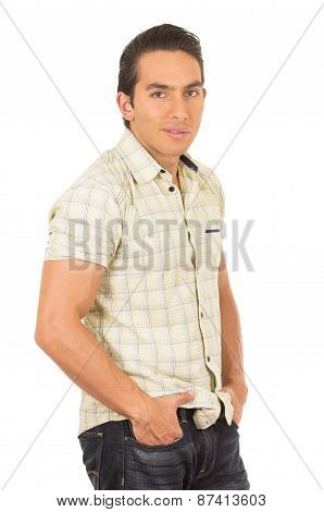 young handsome hispanic man posing with hands in pockets