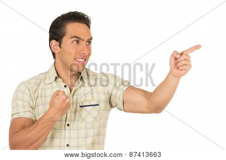 handsome young casual man posing pointing to the side