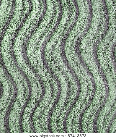 Sandy beach background. Sand texture with waves from the wind. Top view, summer background