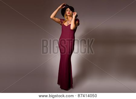 fashion young woman full length on a grey background