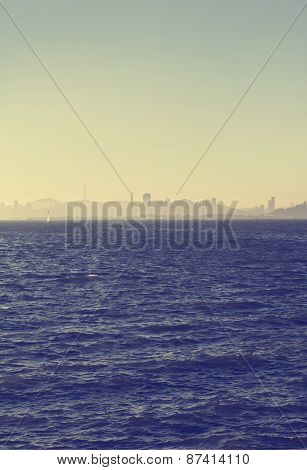 San Francisco downtown cityscape from the bay, retro photography, bay bridge, golden gate bridge