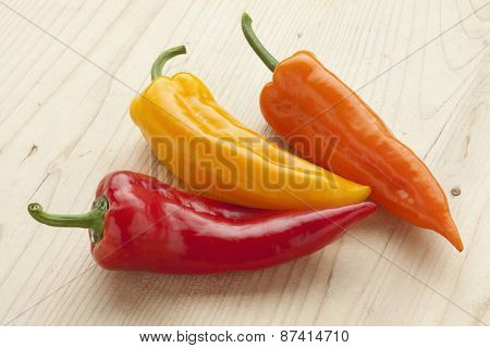 Fresh sweet red, yellow and orange pointed bell peppers