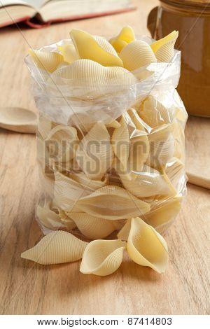 Traditional Italian conchiglioni rigati in a cellophane bag