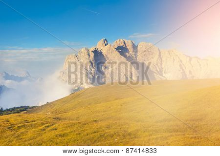 Great view of the foggy Cristallo ridge from Monte Piana in National Park Tre Cime. Dolomites, South Tyrol. Location Auronzo, Italy, Europe. Dramatic scene. Beauty world.