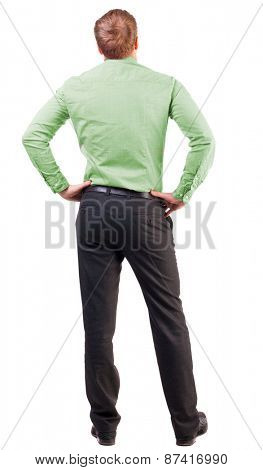back view Business man  looks ahead. Young guy in pink shirt watching. Rear view people collection. Isolated over white background. broad-office worker put his hands on his hips thoughtfully reflects