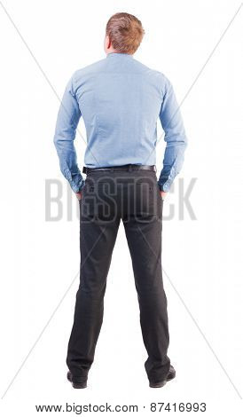 back view business man  in red shirt looks ahead. Young businessman watching.     backside view of person.  Isolated over white background. office worker with a sports figure looks away