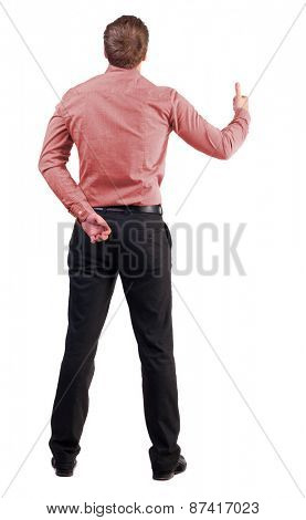 Back view of  business man shows thumbs up.    backside view of person.  Isolated over white background. with one hand behind his back, an office worker second shows gesture success