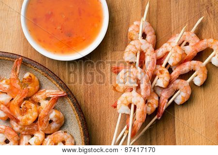grilled prawns on wooden table