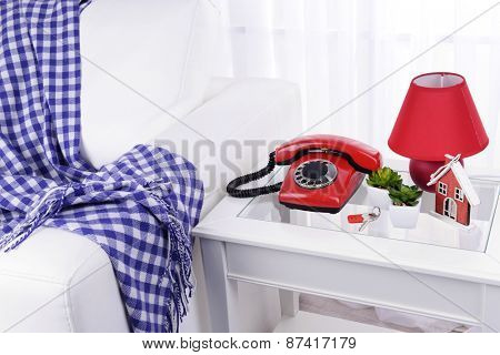 Retro phone on nightstand in room