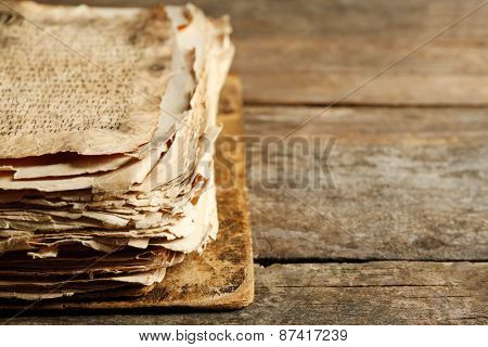 Grunge papers with hieroglyphics  on wooden background