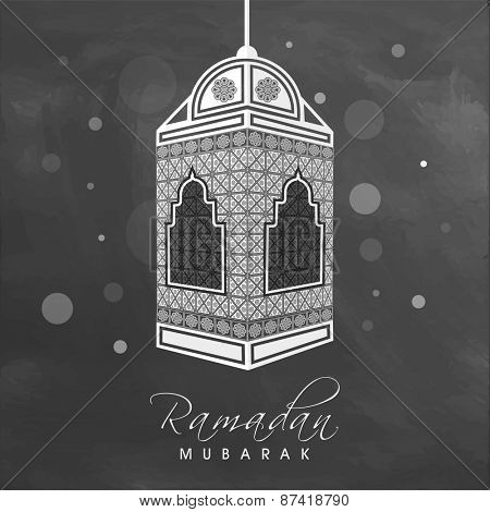 Traditional beautiful arabic lamp hanging on grungy background for holy month of muslim community, Ramadan Kareem celebration.