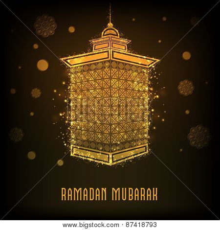 Golden shiny floral decorated traditional arabic lamp for holy month of muslim community, Ramadan Kareem celebration.