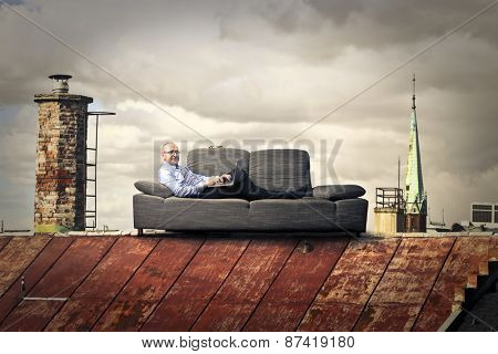 Businessman relaxing on the sofa